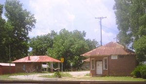 Note:  The picture above is the old filling station on the left and the post office and a grocery store on the right.